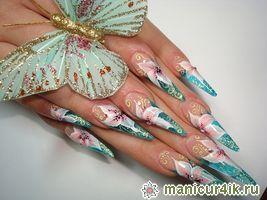 Новогодний дизайн острых ногтей фото